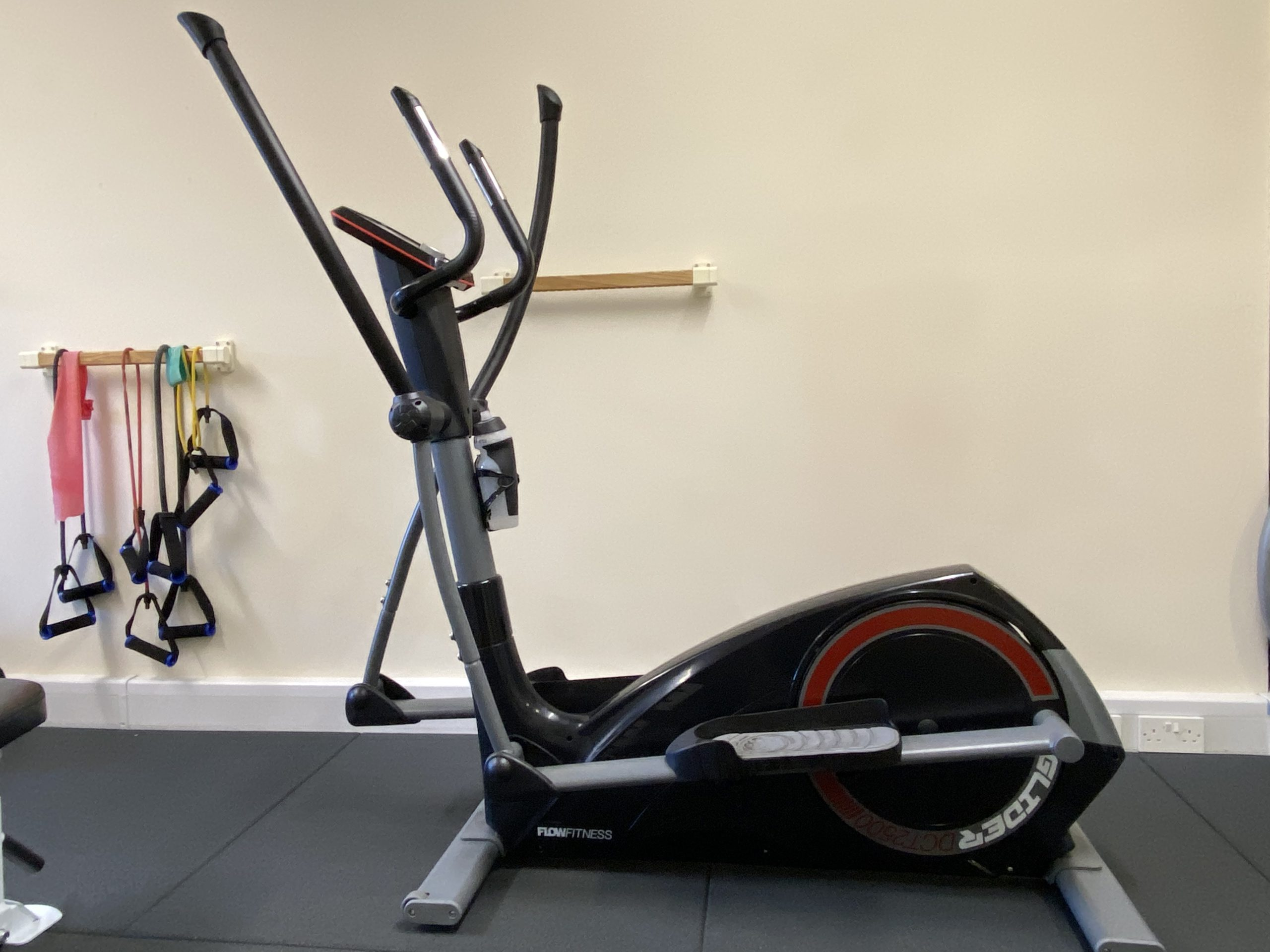 Elliptical cross trainer and resitance bands in gym