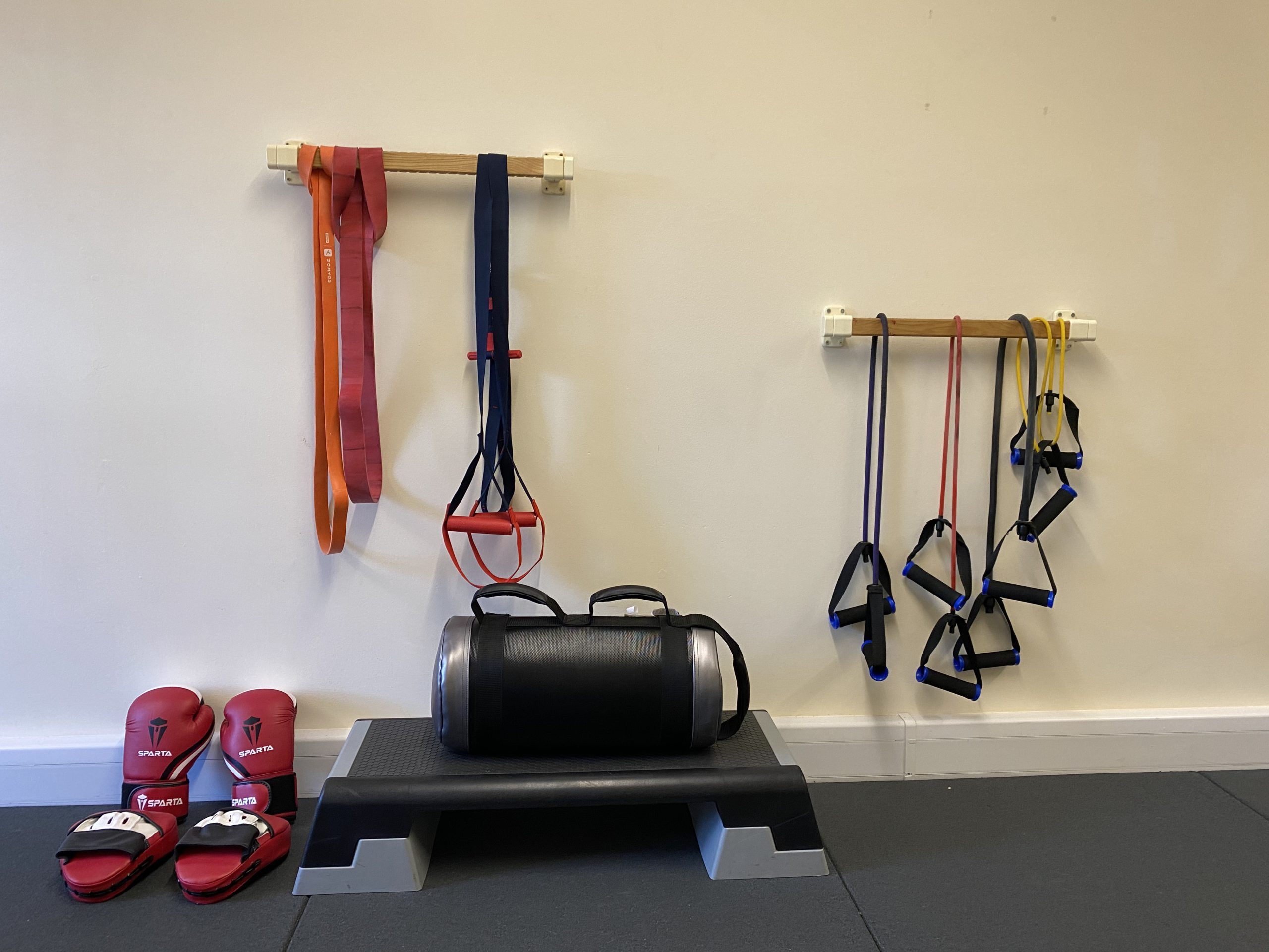Resistance bands, boxing gloves and pads, power bag and step in gym