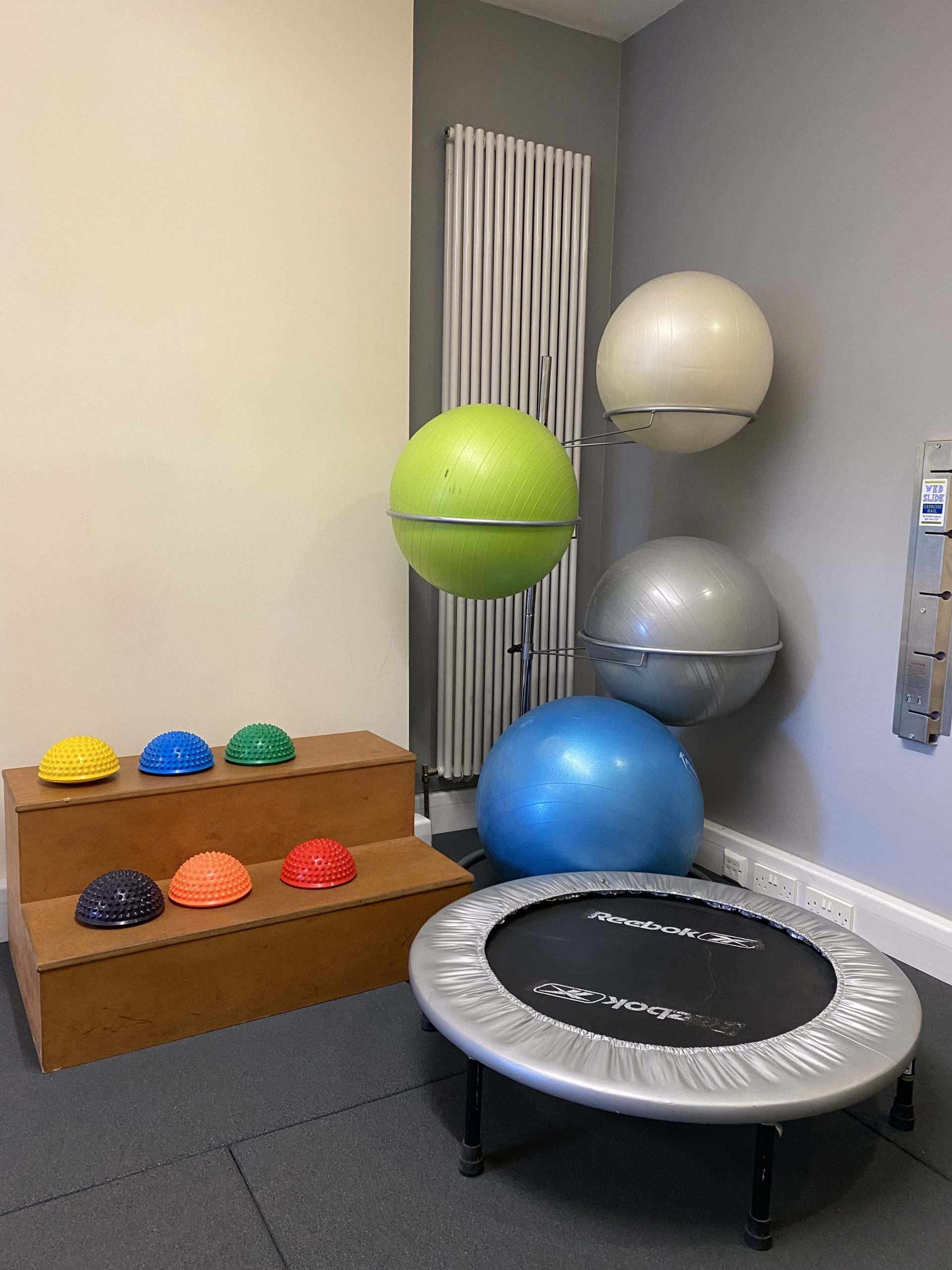 Swiss balls, gym balls, mini trampoline and wobble trainers for stability exercises