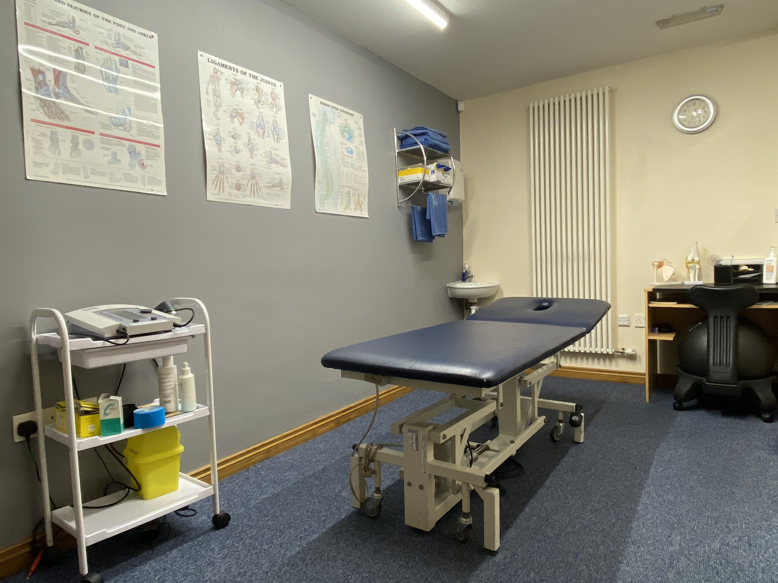 Physio treatment room with table and equipment