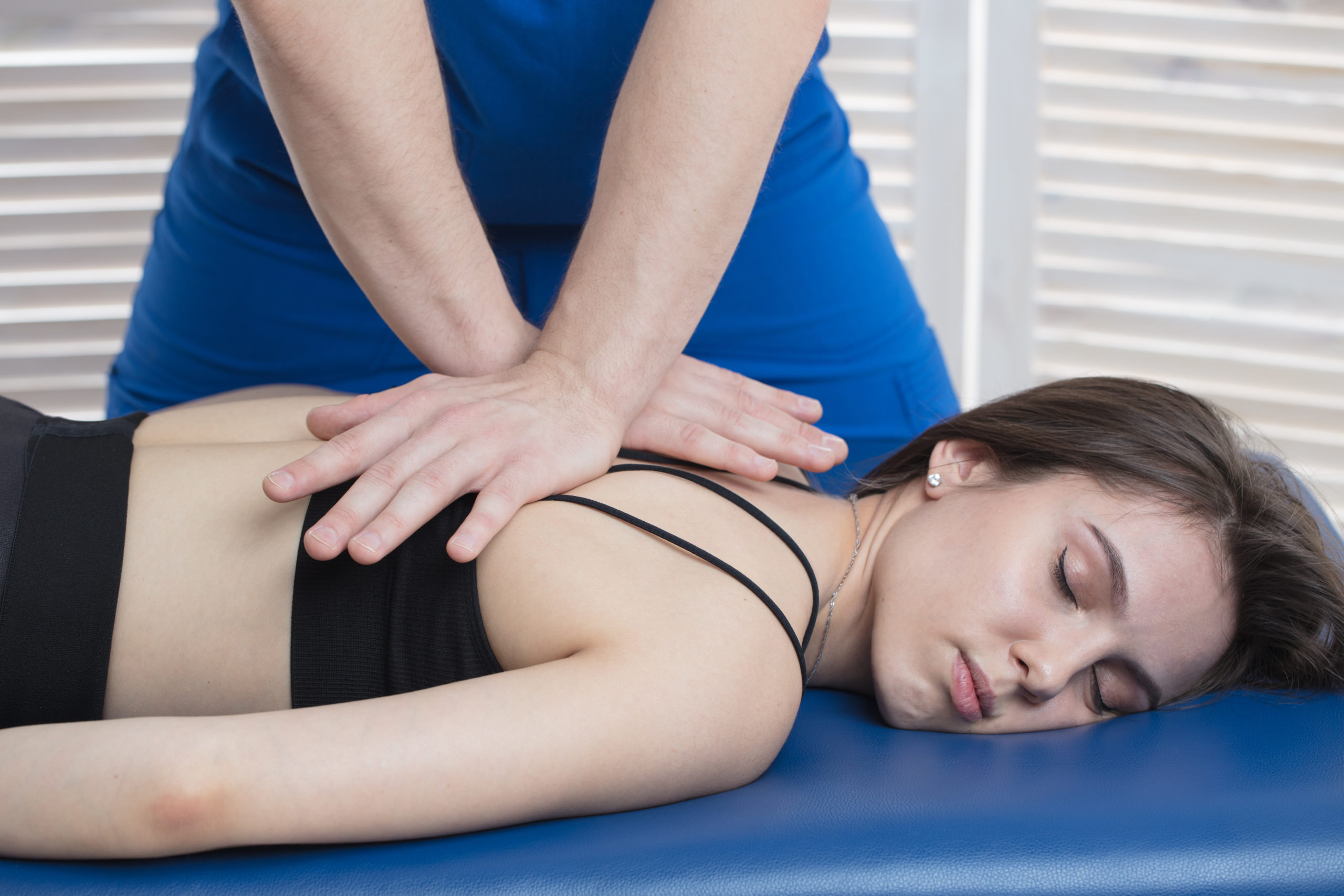 Physiotherapy mobilisation and manipulation treatment of a back injury
